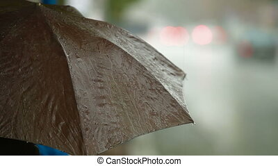 People under umbrellas in heavy rain