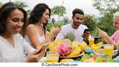 People Using Cell Smart Phones Talking Eat Healthy...