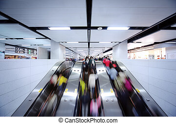 People using escalator - Many people using escalator,...
