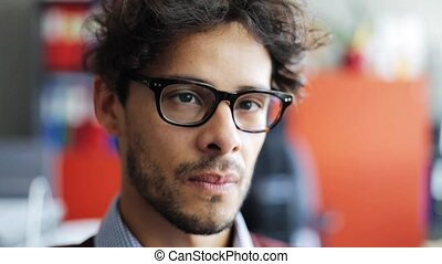 smiling young man in eyeglasses - people, vision, emotion...