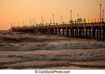 Palanga pier - People waching the sunset on the Palanga...