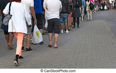 People waiting in line - Feet of people in casual clothes...