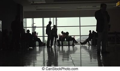 People waiting in the boarding lounge at the airport