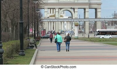 People walk along the Boulevard. Cityscape, the road on the ambulance ride cars and trams. Spring day in the city