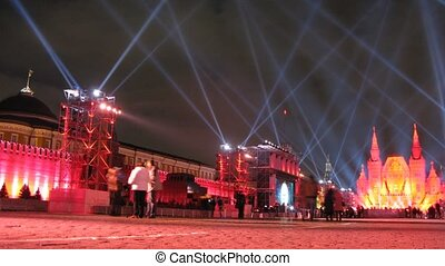 People walk and are photograph on Red Square on festival CIRCLE OF LIGHT