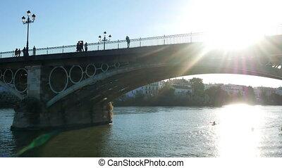 People walk bridge