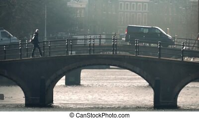 People Walk, Cycle On Bridge Bokeh