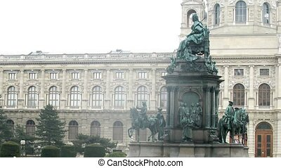 People walk in front of Natural Museum when in rain - VIENNA...