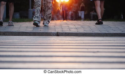 People walk in the evening city at sunset, in the frame you...
