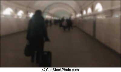 people walk in the winter underpass in the subway....