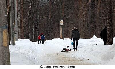 people walk in winter park