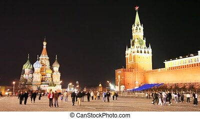 People walk near Kremlin on Red Square in Moscow