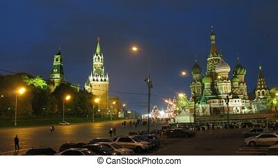 People walk near sacred Vasily cathedral in evening