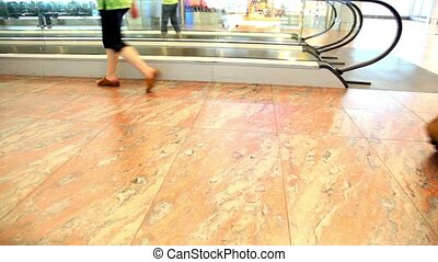 People walk next to the handrail of the escalator, we can...