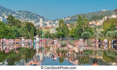 People walk on a Promenade du Paillon park timelapse, famous...