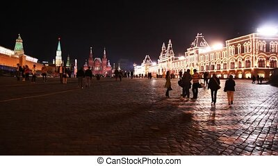 People walk on Red Square in Moscow
