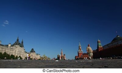 People walk on Red Square. Sunny day. - People walk on Red...