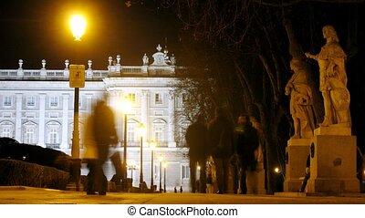 People walk on square Plaza de Oriente near king palace in...