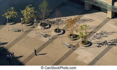 People Walking Across City Plaza - Birdseye view of plaza ...
