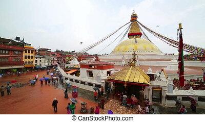 People walking around Buddha's Eyes as religious ritual,...