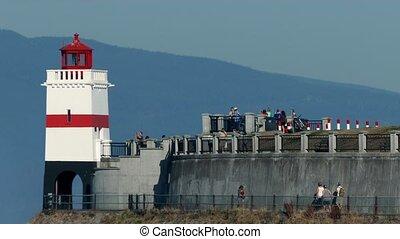 People Walking Around Lighthouse