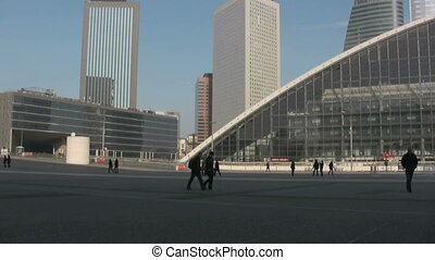 People walking at La Defense, Paris - View in a sunny day