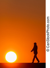 People walking at sunset