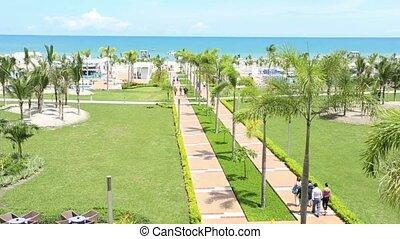People walking at tropical beach re
