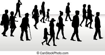 People walking, black silhouettes.