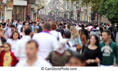 people walking in a crowded street