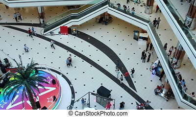 people walking in a shopping center