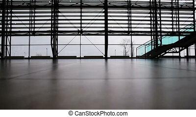 People walking in airport terminal - Man and woman walking...