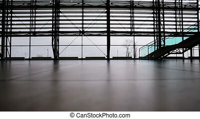 People walking in airport terminal - Man and woman walking...
