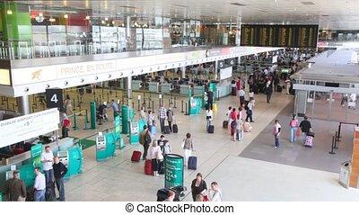 People walking in Dublin Airport interior in Dublin,...