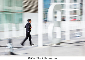 People walking in the business district, motion blur