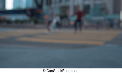 Pedestrians walking in the city. Out of focus background