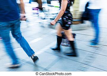 people walking in the pedestrian area in motion blur - ...