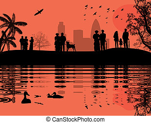 People walking on a park with lake