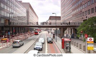 People walking on bridge near Waterloo Station in London,...