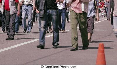 People walking on busy city street.