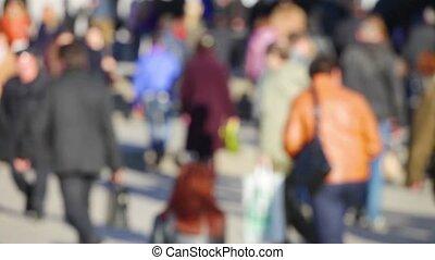 people walking on busy street