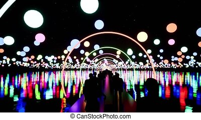 People walking on illuminated bridge at night 3d animation. Male and female black silhouettes moving on futuristic pathway with neon arcs. Travellers with luggage arriving in megapolis