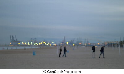 People walking on the beach on a cold day