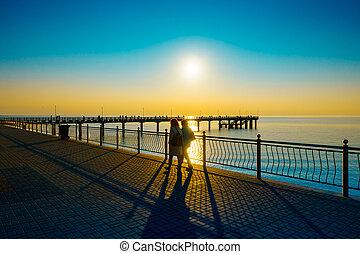 People walking on the embankment at Baltic Sea coast