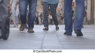 People walking on the street, legs