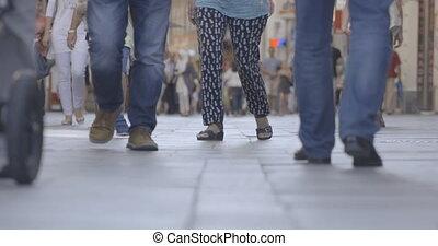 People walking on the street, legs
