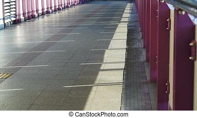 people walking on train bridge