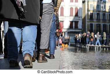 People walking on walkway in Venice