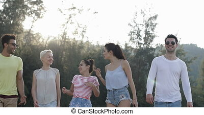People Walking Outdoors Talking In Mountain Park, Young Friends Group Communication