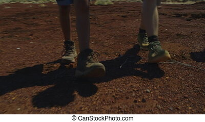 People walking through the outback - A low angle shot of...